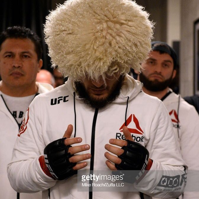 Khabib Praying before his championship fight against Al laquinta. The wool cap he is wearing is hid region's traditional head gear for protection against cold mountain winds.
